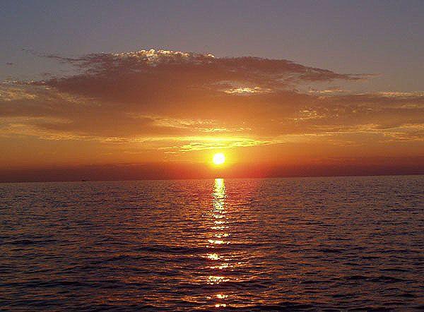 Západ slunce nad mořem, slovinsko
